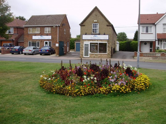Flowers on Eaton Ford Green and Mortgage Brokers at 8 Eaton Ford Green in September 2009 (P.Ibbett)
