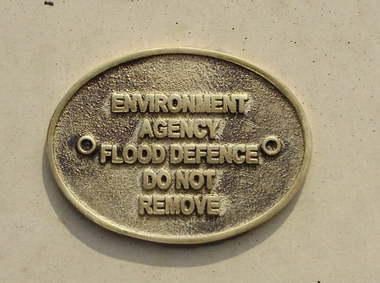 Small flood defence plaque attached to the flood defences in Eaton Ford, in September 2009 (P.Ibbett)