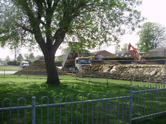 Lorry unloading soil to create the bank for the new flood defences in the Riverside Park in April 2009, near the children's play area (P.Ibbett)