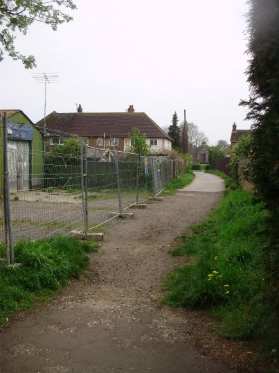 Perry and Saunders garage on the left, just off Mill Hill Rd in Eaton Ford, in April 2009, disused and waiting to be developed  (P.Ibbett)