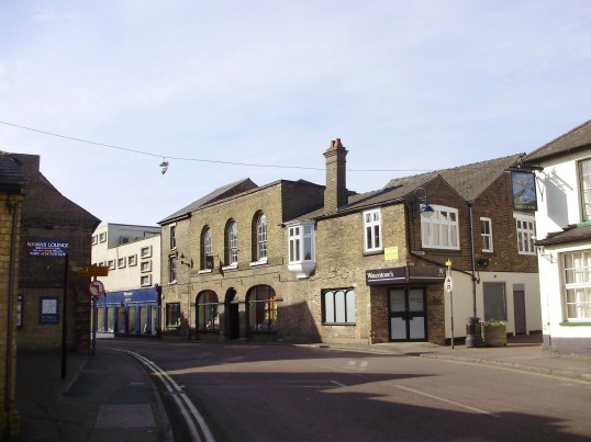 Waterstones Book Shop in Barrett's, New Street, St Neots in March 2009 - note the pair of trainers hanging above the road (P.Ibbett)