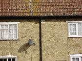 Date plaque of 1799 on old cottages in Mill Lane, St Neots, photographed in March 2009 (P.Ibbett)