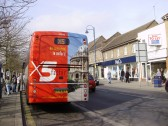 X5 coach in St Neots Market Square with Cambridge scene on the back, runs from Oxford to Cambridge in March 2009 (P.Ibbett)