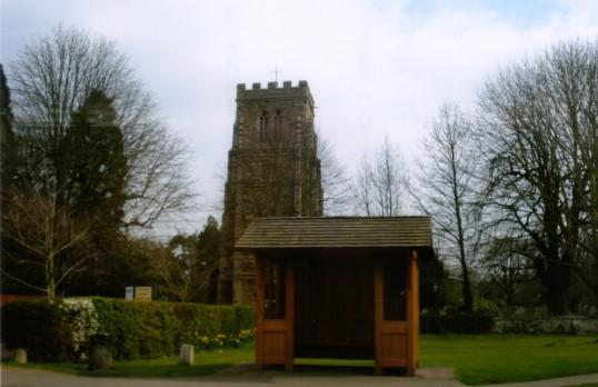 Eaton Socon St Marys Church and bus shelter on Eaton Socon Village Green in March 2011