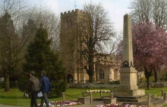 Eaton Socon War Memorial on Eaton Socon Village Green and St Marys Church in March 2011