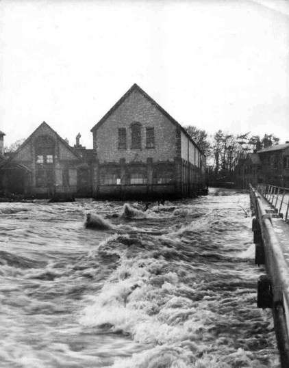 Paper Mill at Little Paxton in the 1947 floods. The Traps walkway is just above the floodwater.