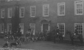 Cambridgeshire Hunt meet in front of Paxton Hall, and in the side drive, around 1930