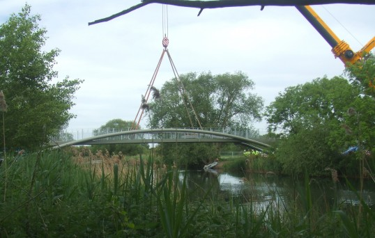 The new cycle/footbridge being lifted into position across the River Great Ouse, May 25th 2011