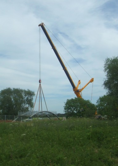 View from Eaton Socon of the new cycle/footbridge being lifted into position across the River Great Ouse - May 25th 2011