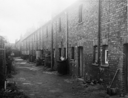 Waterbutt Alley, rear of houses in Russell Street, St Neots, in 1963. The water in the well at one end was purer than tap water !