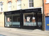Escape Tanning and Beauty Studio in the former Sue Ryder charity shop in New Street, St Neots in April 2011