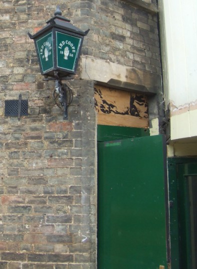 Old lamp above the back door of The Wrestlers in New Street, St Neots in August 2011