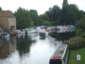 Boats moored at Houseboat Corner in 2011 - on the River Great Ouse at the entrance to Henbrook