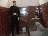 A prisoner in the police cell at St Neots Museum, New Street, in August 2011