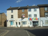 Essentials Salon, Trillium Offices and Party Jacks shop in New Street, St Neots in August 2011