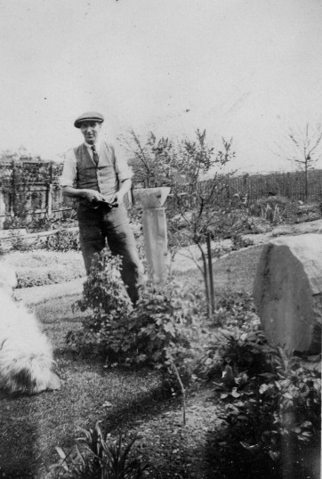 Eaton Socon - Austin James Barringer in the garden at River Cottage, 32 Ackerman Street, around 1935. Note the carved stone from Eaton Socon Church after the fire.