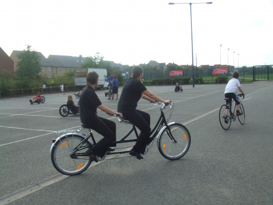 Trying a tandem and other bikes at the Cycle Experience day at Ernulf Academy - to celebrate the opening of the new Willow Bridge, in September 2011