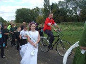 Eatons May Queen and Rohan Wilson (from Sustrans) on his bike in the procession along the path after the official opening of Willow Bridge on September 21st 2011