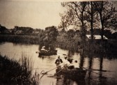 Boating on the river with Eaton Socon Church in the background and boathouse on the McNish field near the river, around 1910