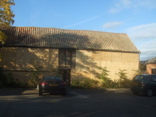 The boarded side of a barn about to be altered at Crosshall Manor, 516 Great North Rd in October 2011.