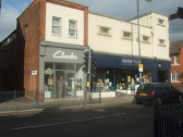 Clarks and Barrett's Shops in St Neots Market Square in October 2011 - note the altered shop front of Clarks
