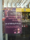 Clare Banks Holistic Treatment poster in the shop window of 'House of Hair' in St Neots High Street in October 2011