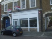 Harrold's Opticians shop in St Neots Market Square in October 2011 - now closed