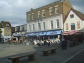 A sunny October afternoon in St Neots Market Square in 2011 with Neros Coffee Shop and the Market Cafe