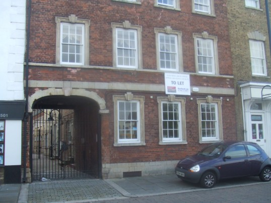 'Offices to Let' in St Neots Market Square, in October 2011, in the former Paines Brewery buildings
