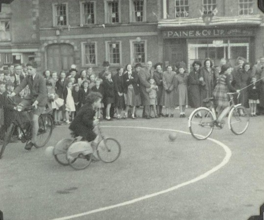 'Burst a balloon on cycles race' in St Neots Market Square at the 1952 St Neots Carnival (photo from Oscar Chuter)
