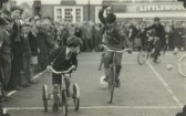 'Burst a balloon on cycles' race in St Neots Market Square at the 1952 St Neots Carnival (photo from Oscar Chuter)