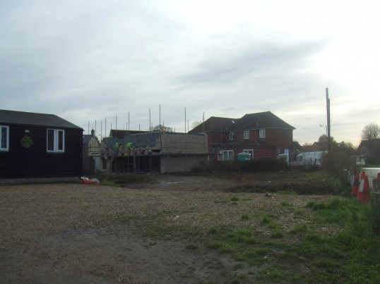 New homes being built behind 7 Eaton Ford Green, Eaton Socon Scout hut on the left in December 2011