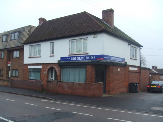 'Advertising Online' in November 2011, at former BSS Security Premises, originally built as Ushers shop in the 1930s, 210 Great North Rd, Eaton Socon