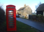 A red telephone box in Staploe village in December 2011 - one of only a few in the area !