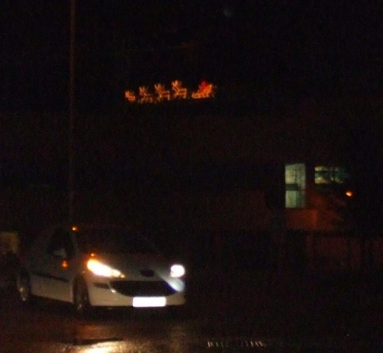 Santa and his reindeer flying near the A428, near Barford Power Station - an annual event