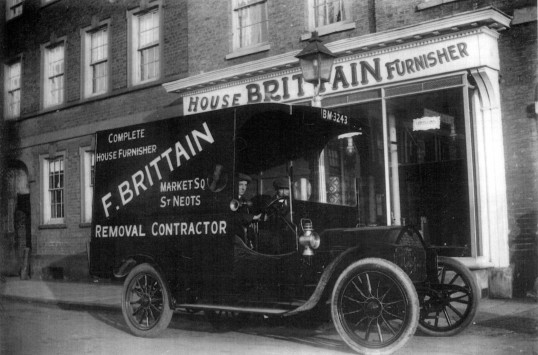 Brittains Furniture house furnishers car around 1913 in St Neots Market Square, van body built from  a crashed Draracq car chassis