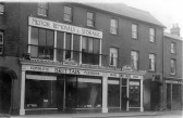 Brittains Stores in St Neots High Street in 1924. Archie Brittain was in charge of the cycles and prams in the workshop down the archway