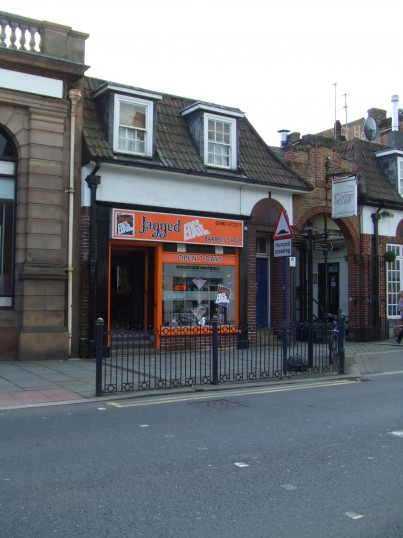 Jagged Edge Barbers Shop in St Neots Market Square, opened May 2012 in the former betting shop