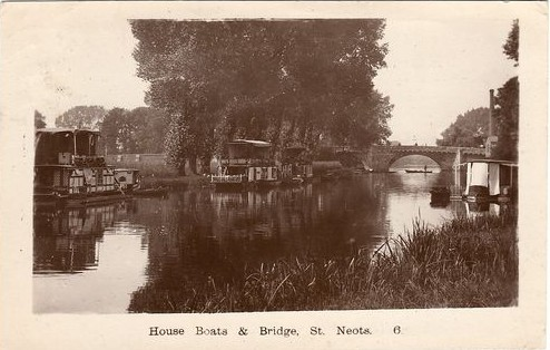 View of houseboats on the River Great Ouse looking north towards the river bridge in 1921