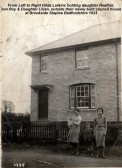 The Larkins family outside their new council house at Staploe village in 1933