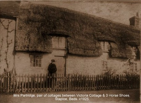 Mrs Partridge outside a pair of cottages between Victoria Cottage and the 3 Horseshoes in Staploe, about 1925 (N. Cutts)