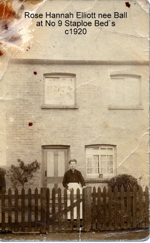 Rose Hannah Elliott, nee Ball, outside her house at 9 Staploe around 1920 (gt gran to Nigel Cutts)