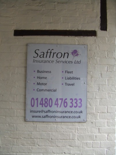 Saffron Insurance notice by the door in Cross Keys Mews in St Neots Market Square in April 2012