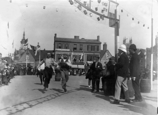 Mens running race in St Neots Market Square as part of the Queen Victoria's Diamond Jubilee Celebrations in June 1897