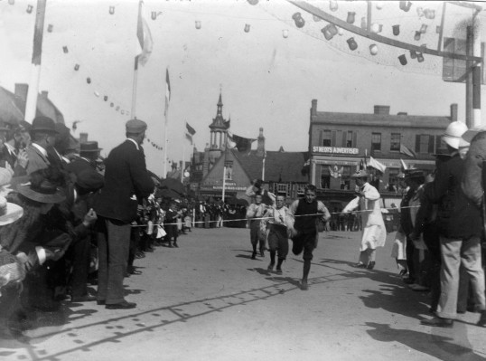 Boys running race in St Neots Market Square as part of the Queen Victoria's Diamond Jubilee Celebrations in June 1897