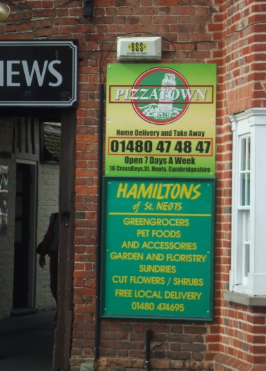 New PizzaTown sign on the former Queen Bee sign at the entrance to Cross Keys Mews in St Neots in July 2012