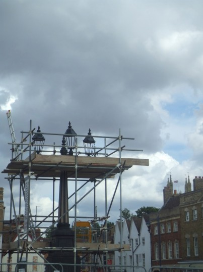 Days Column in St Neots Market Square with only 3 lamps after being damaged on 2nd August 2012