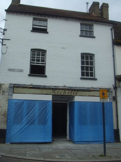 'Michelle' shop sign revealed during renovations in August 2012 to the former A N Audio shop which is soon to be a Turkish Restaurant in St Neots Market Square