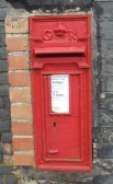 This post box on a wall in Duloe - dates from the era of King George (possibly from 1910-photo taken on 12th Sep 2012)