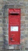 A Victorian wall letter box in Staploe - possibly in situ by 1877 when mentioned in the Post Office Directory, cleared at 6am daily (photo Sep 2012)